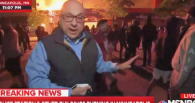 (WATCH) MSNBC's Ali Veshi Says Minneapolis 'Protesters' Not 'Unruly' … While Standing In Front of a Burning Building